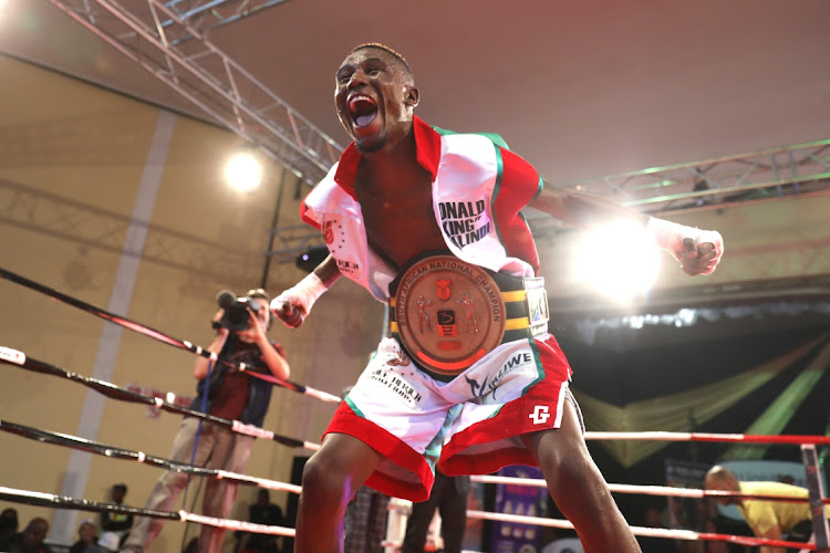 Ronald Malindi gestures to the crowd after defeating Michael Daries during the SA Bantamweight title fight at the Orient Theatre.