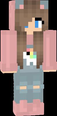 Menina unicórnio de roupa azul casaco rosa cabelo castanho