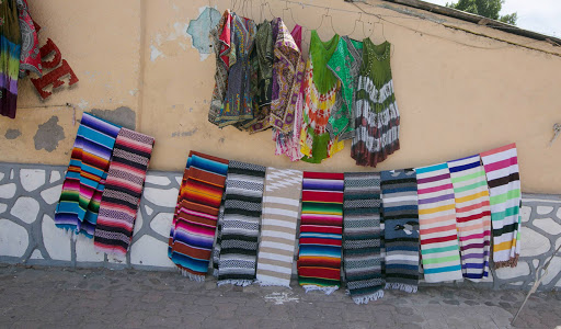 Fabulous-tapestries-in-Loreto.jpg - Colorful fabrics along the main thoroughfare in Loreto. Many travelers from throughout the region come to Loreto for these weavings.