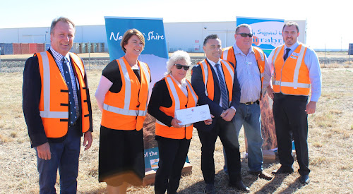 State Member for Barwon Kevin Humphries, Roads, Maritime and Freight Minister Melinda Pavey, Narrabri Shire Mayor Cathy Redding, Deputy Premier John Barilaro, Deputy Mayor Cameron Staines and Narrabri Shire Council general manager Stewart Todd with a cheque for re-sealing the Wee Waa Pilliga road, presented at Louis Dreyfus Company's Narrabri site on Friday.