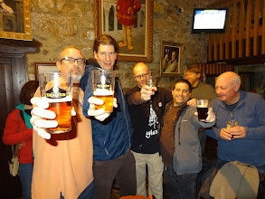 Photo: We land at Theakston's Brewery in Masham. Jim Hatsell, Lee Dickson, Brian Roth and Dan Rosen raise a toast - with a pub regular photo bomber to the right.