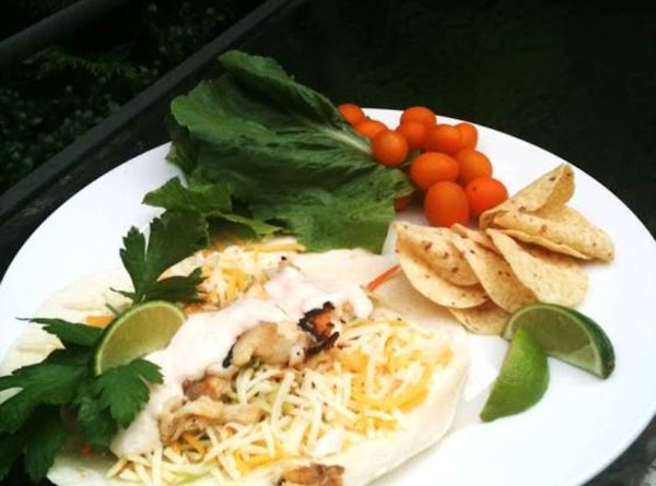 Assemble tacos using flour tortillas and cheese. Place flour tortilla on plate, spread on...
