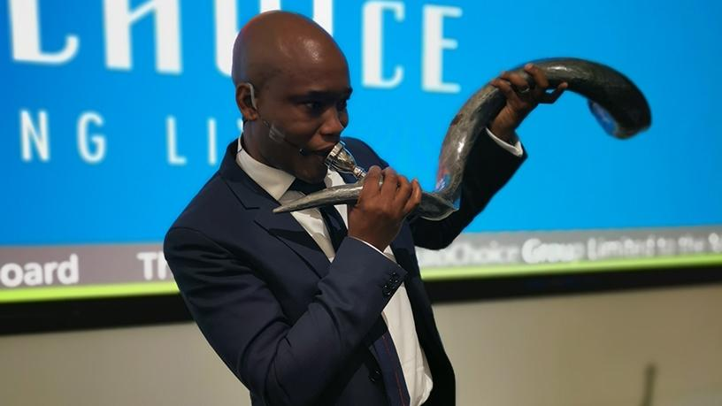 MultiChoice Group CEO, Calvo Mawelo, blows the trumpet as the company makes its JSE debut.