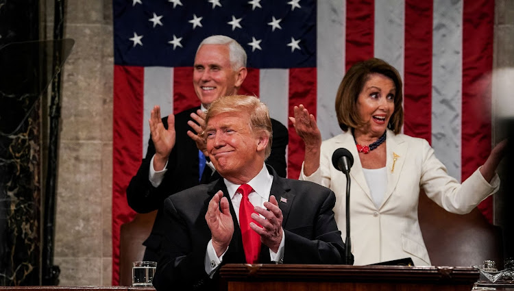 President Donald Trump, with Vice-President Mike Pence and speaker of the house Nancy Pelosi, at the Capitol in Washington, DC, the US, on February 5 2019. Picture: REUTERS/DOUG MILLS