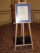 Photo: Cathy Godin presented the newly re-framed original ASHRAE OVC Charter document, circa 1952