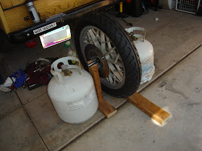 Photo: My VERY ghetto tire balancing contraption. Don't think it worked too well, as I had to get the tire re-balanced at a real shop.