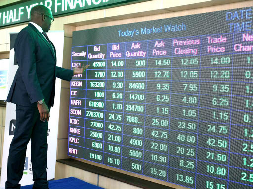 NSE chief executive Geoffrey Odundo monitors the daily trading at the Nairobi Bourse/