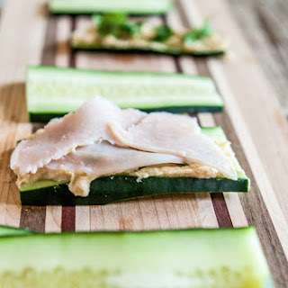 Cucumber Sandwiches with hummus, turkey and cilantro.