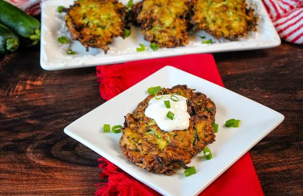 Creamy Zucchini Pancake With Sour Cream On A Plate.