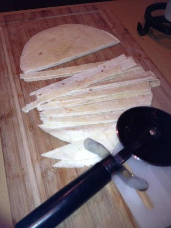Preheat oven to 300, place tortillas that have been cut in to thin strips...