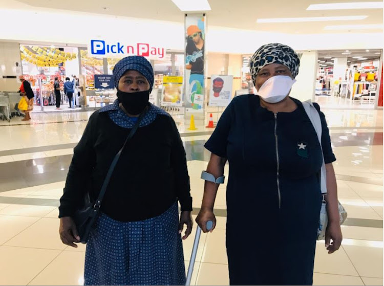 Luziwe Nkomo and Matilda Modibedi beamed with joy and gratitude after receiving their pension grants at Randburg Square on Tuesday.