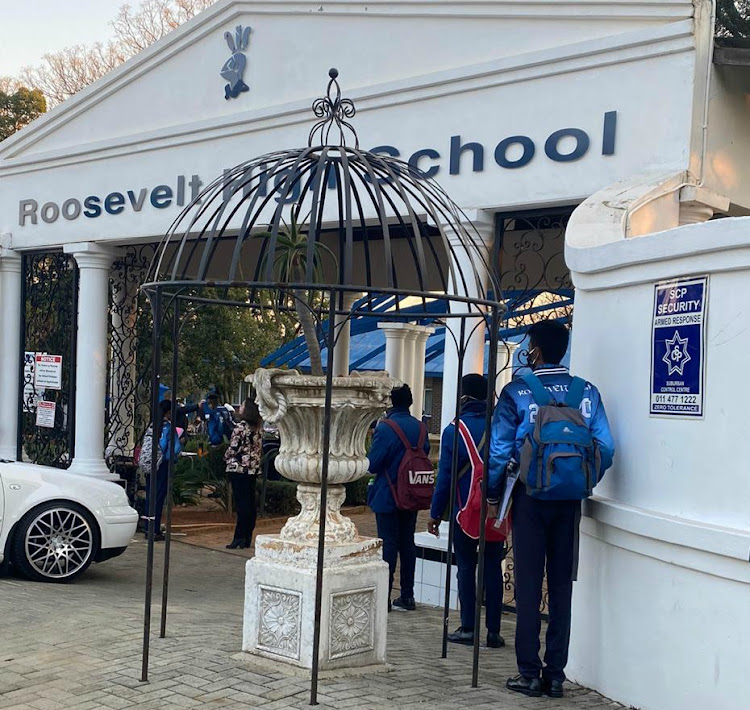 Pupils were greeted at the entrance to their school as part of their orientation on the first day back in class during the coronavirus pandemic.