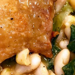Braised Chicken Thighs with Escarole and Cannellini Beans.