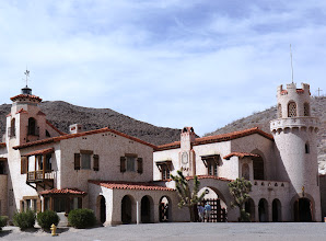 "Photo: Scotty's Castle is not a real castle, and it did not belong to the ""Scotty"" (Walter Scott) from whom it got its name. Scotty died in 1954 and was buried on the hill overlooking Scotty's Castle next to his beloved dog. You can see his grave marker on the hilltop at the far right."