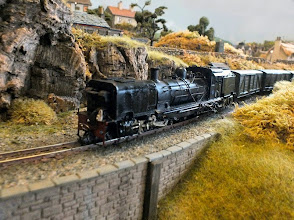 Photo: 016 Back on dry land and a heavy goods train passes through with an NGG16 Garratt working hard up the gradient .