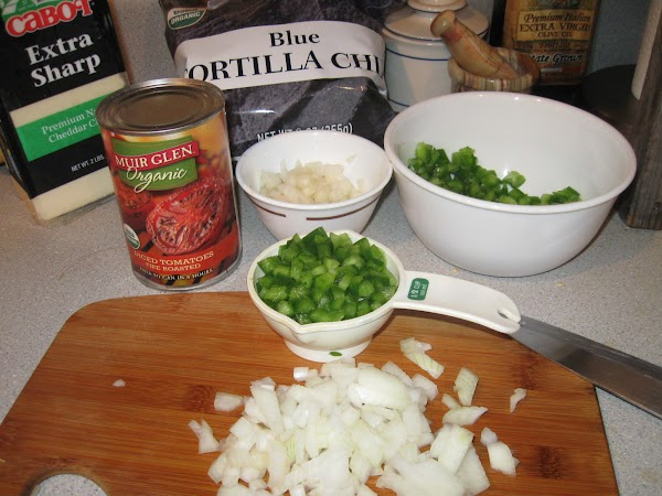 Dice onion and bell pepper. Hold back 1/3 cup dice onion for garnish.