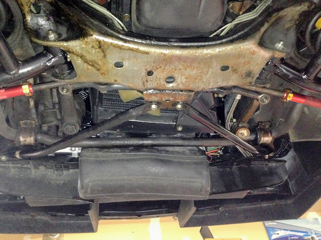 Underside prior to removal of OE swaybar. Note the diagonal braces. They'll have to go.