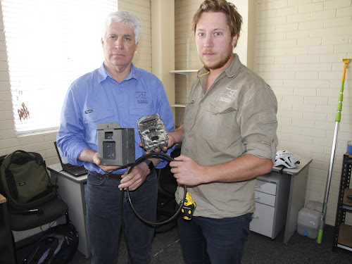 Australian Wildlife Conservancy NSW Project Co-ordinator Joe Adair, left, and Wildlife Ecologist Dr Lawrence Berry with camera case, cabling and camera similar to the 12 stolen.