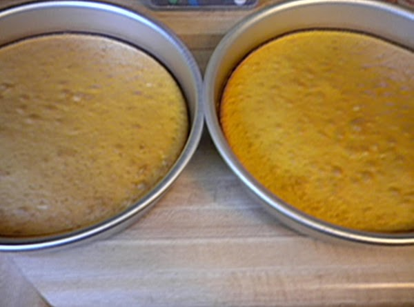 Preheat oven to 350. Mix up the yellow cake mix following directions on box....