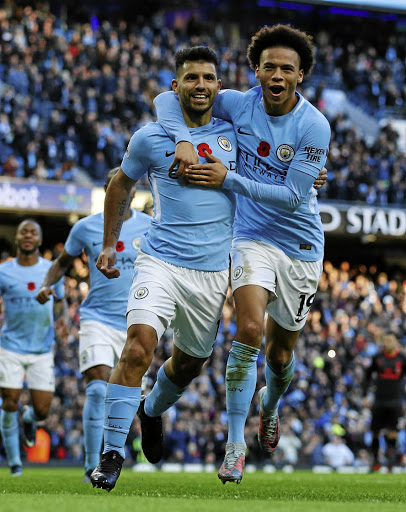 Glory boys: Manchester City's Sergio Aguero, left, celebrates scoring their second goal with teammate Leroy Sane. Picture: REUTERS