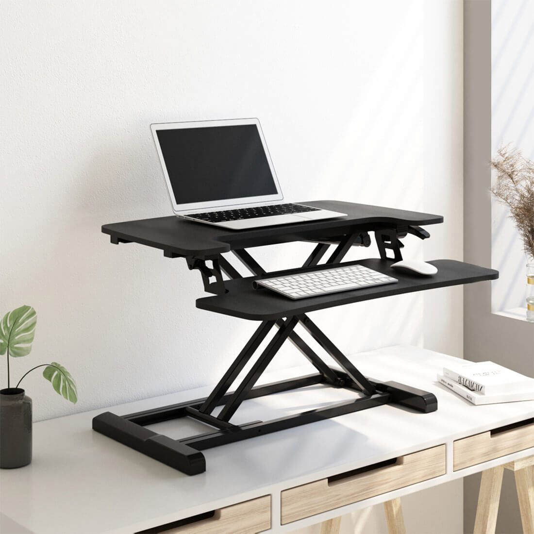 FLEXISPOT Stand Up Desk Converter is a desk riser rather than a standing desk for those who wants to convert traditional desk into an active sit/stand desk