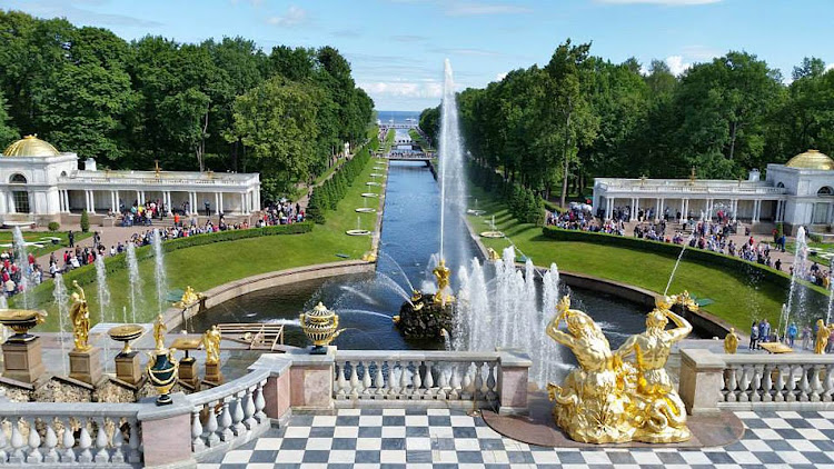View of the grounds from the steps of Peterhof Palace in St. Petersburg, Russia.