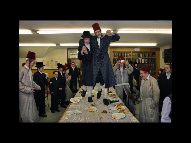 Photo: 27 Mar 2005, London, England, United Kingdom --- During the Jewish festival of Purim a group of Orthodox Jewish boys from the Viznitz Yeshiva (school) in fancy dress celebrate the festival with a feast. The evening quickly moves onto dancing on the tables that sends food flying everywhere. The school boys drink large amounts of alcohol throughout the day and night. --- Image by © Andy Aitchison/Corbis