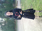 Photo: guy with debian t-shirt and speical kilt with a lot of pockets