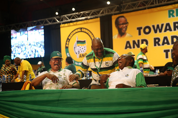 Jacob Zuma, Cosatu president Sdumo Dlamini and Cyril Ramaphosa share a joke before the outgoing NEC is dissolved at the 54th ANC Elective Conference at Nasrec in Johannesburg on 18 December 2017.