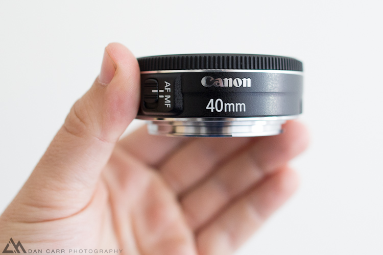 Photo: Canon's new 40mm f2.8 STM Pancake lens in my hands!!  I took some photos and made an introductory video about it. I'll be working on a full review as well in the coming few days. This is a VERY cool lens!  http://dancarrphotography.com/blog/2012/06/20/hands-on-with-the-new-canon-40mm-f2-8-stm-pancake-lens/