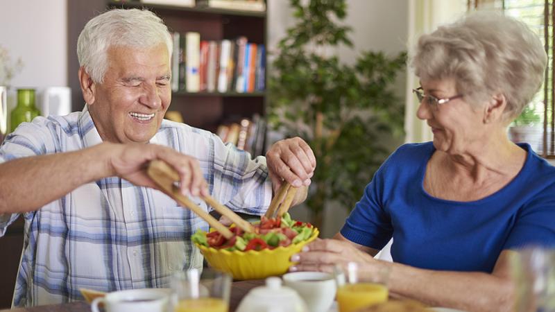 Elderly couple having healthy food