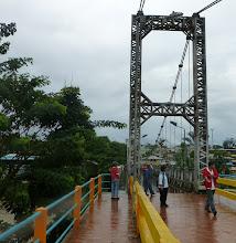 Photo: Pedestrian bridge across the river in Tena