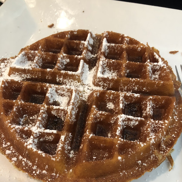 Gluten free chocolate chip waffle with maple syrup. Delicious.