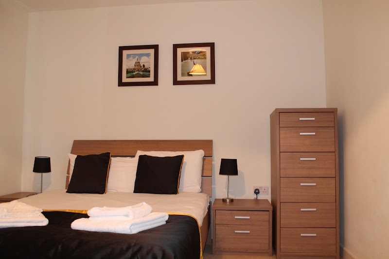 modern bedroom city reach serviced apartment