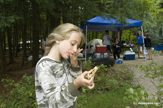 Photo: Jacklyn Carrara enjoys a smore while camping with her family at Half Moon Pond State Park. Photo by Karen Pike