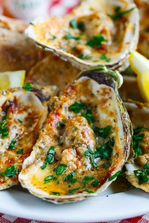 "Chargrilled Oysters ""Oysters on the half shell done NOLA style, filled with..."