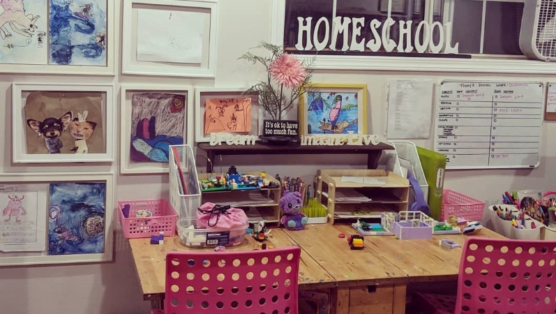 a home learning desk decorated with child's artwork