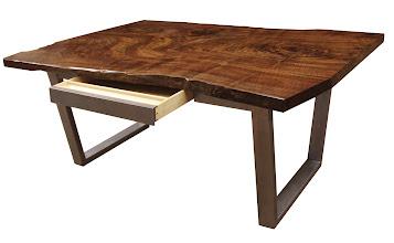 Photo: http://dorsetcustomfurniture.blogspot.com/2012/07/claro-walnut-slab-desk-with-secret.html