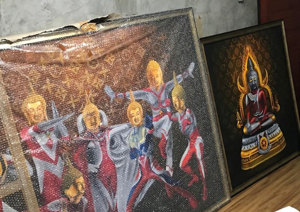 Thai-kuns wat Boeddha as 'n Japannese superheld vertoon, vra die polisie se klag