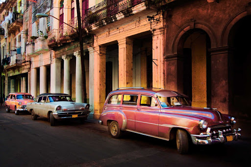 Cuba-Three-Cars-Parked-Along-Row-of-Colorful-Buildings_02.jpg - The colors of Old Havana at sunset.