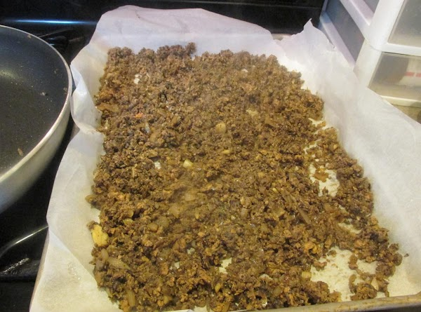 Add a sheet of parchment paper to a large sheet cake pan, and when...