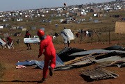 The Red Ants destroyed shacks and houses that had allegedly been illegally built by residents of Kokotela informal settlement in Lawley, south of Johannesburg, on Monday.