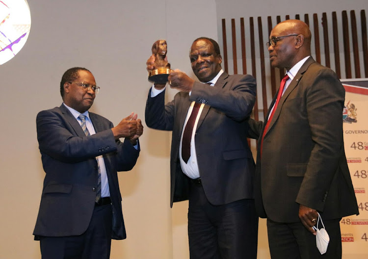 New CoG chairman Martin Wambora, outgoing chairman Kakamega Governor Wycliffe Oparanya and new vice chairman James Ongwae during the official announcement of the new leadership at Movenpick Hotel in Westlands on January 29.