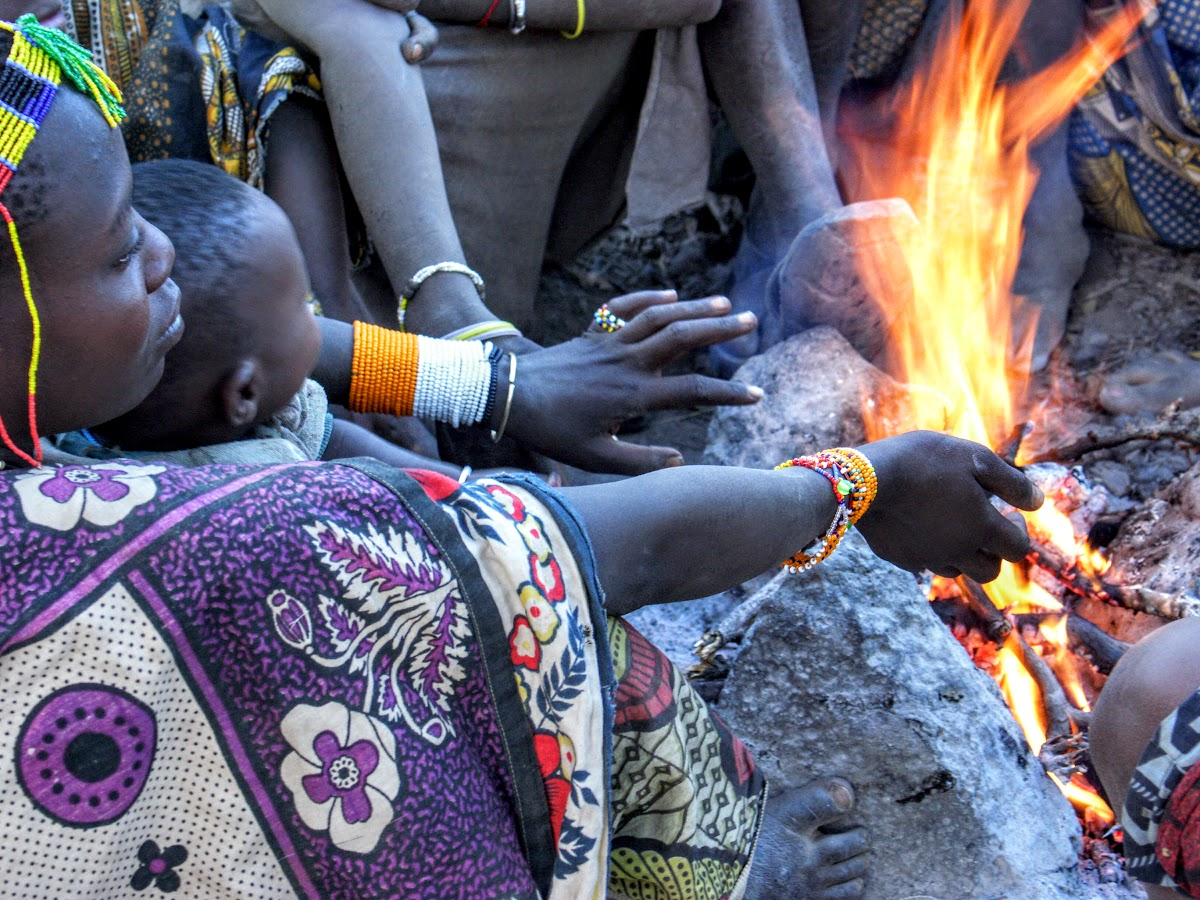Hadzabe women gathered by the fire