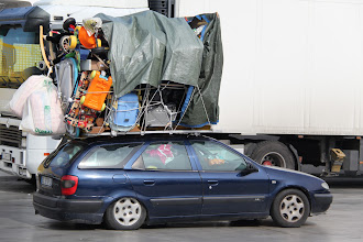 Photo: Overlaiden cars returning to Tunis with everything including the kitchen sink!!