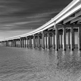 A Bridge Too Far by Christian Skilbeck - Buildings & Architecture Bridges & Suspended Structures ( water, new orleans, black and white, columns, ocean, bridge )
