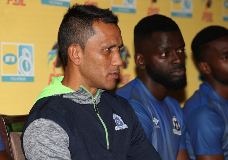 Maritzburg United head coach Fadlu Davids (L) listens to a question during a press conference at Harry Gwala Stadium on September 07, 2017 in Durban, South Africa.