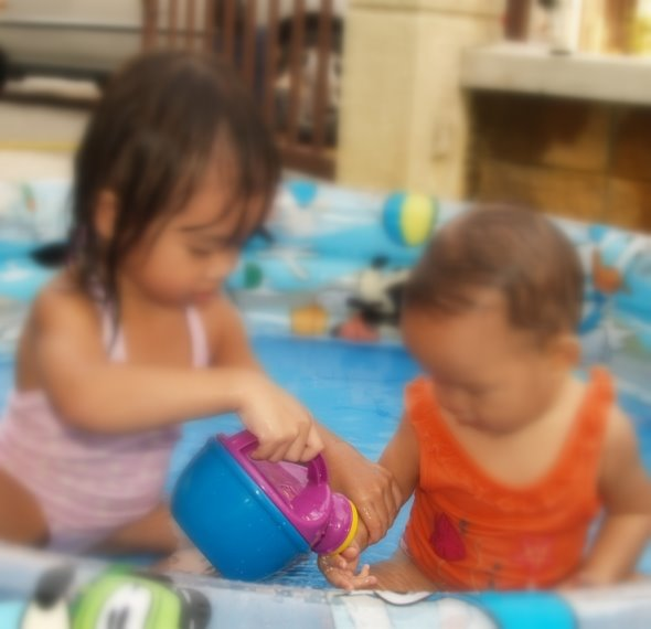 Zara helping Zaria to wash her hands