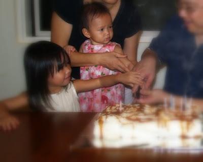 Zaria cutting the cake