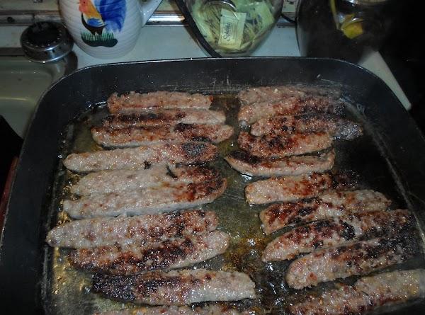 Cook sausage on one side until brown. Turn sausage over.